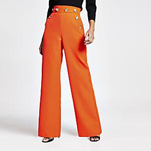 Orange High-Waist-Hose mit weitem Hosenbein und Knopfapplikationen