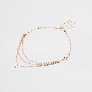 Bracelet de cheville multirang or roseà strass