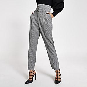 Pantalon fuselénoir et blancà carreaux avec taille corsetée