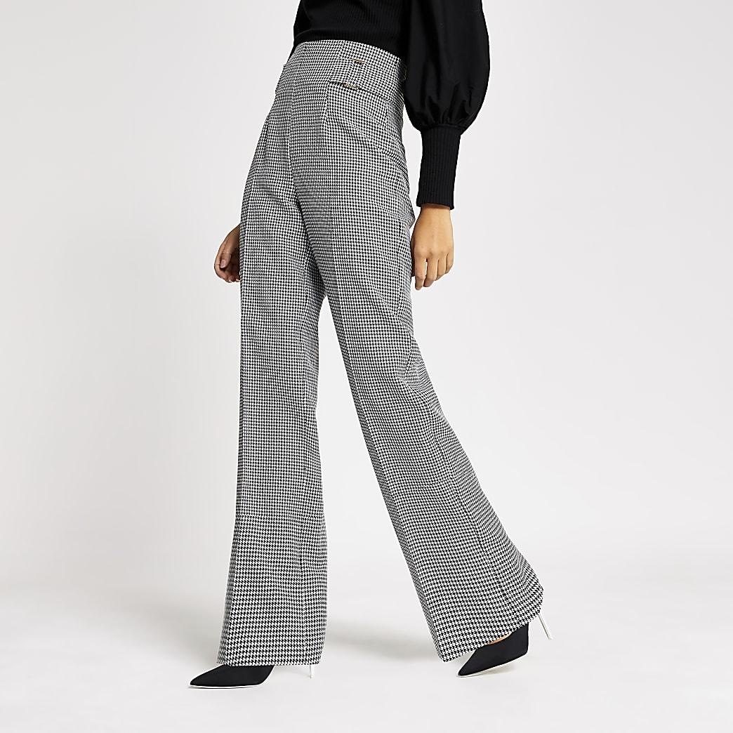 Zwarte broek met wijde pijpen en pied-de-poule-print