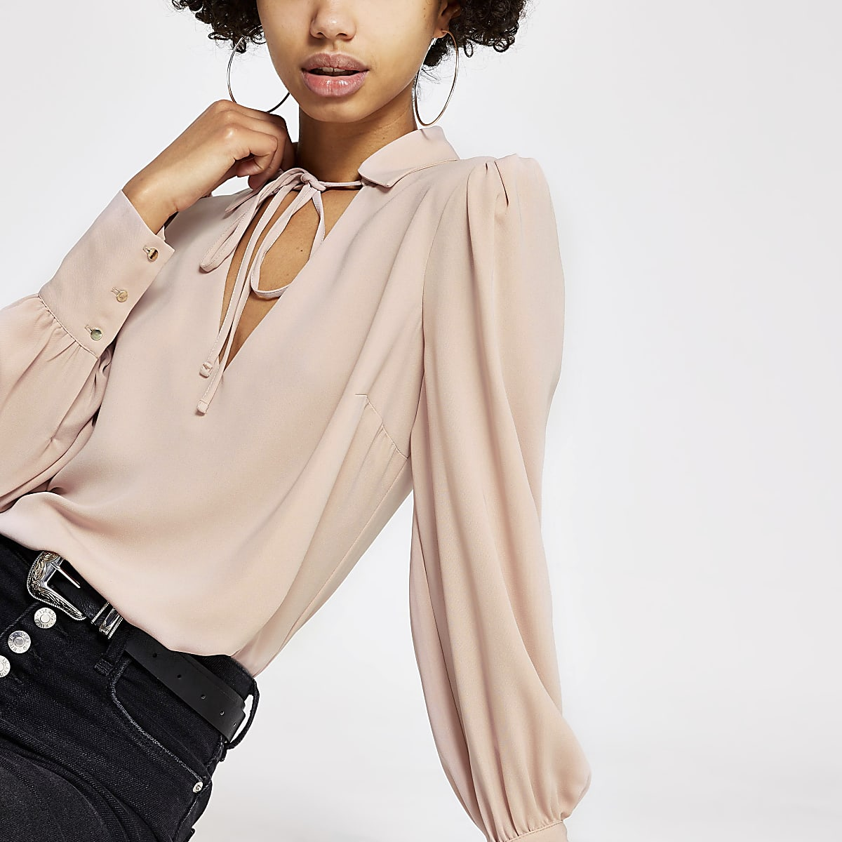 Light pink long sleeve tie neck blouse