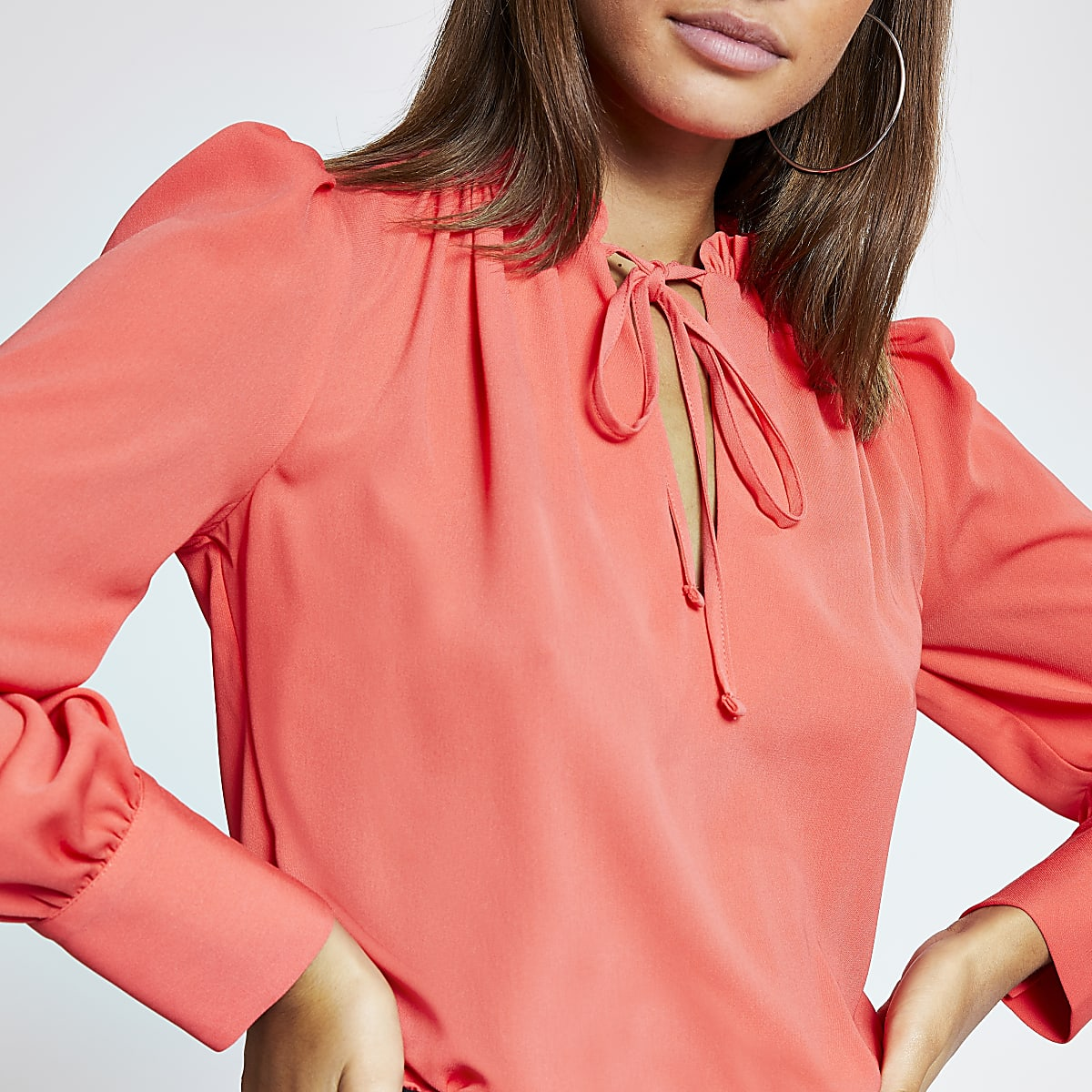 Coral frill tie neck long sleeve blouse