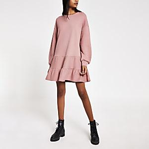 Roze gesmokte mini-sweaterjurk met lange mouwen