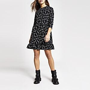RI Petite - Zwarte gesmokte mini-jurk met bloemenprint