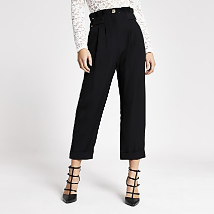 Petite black buckle peg leg trousers