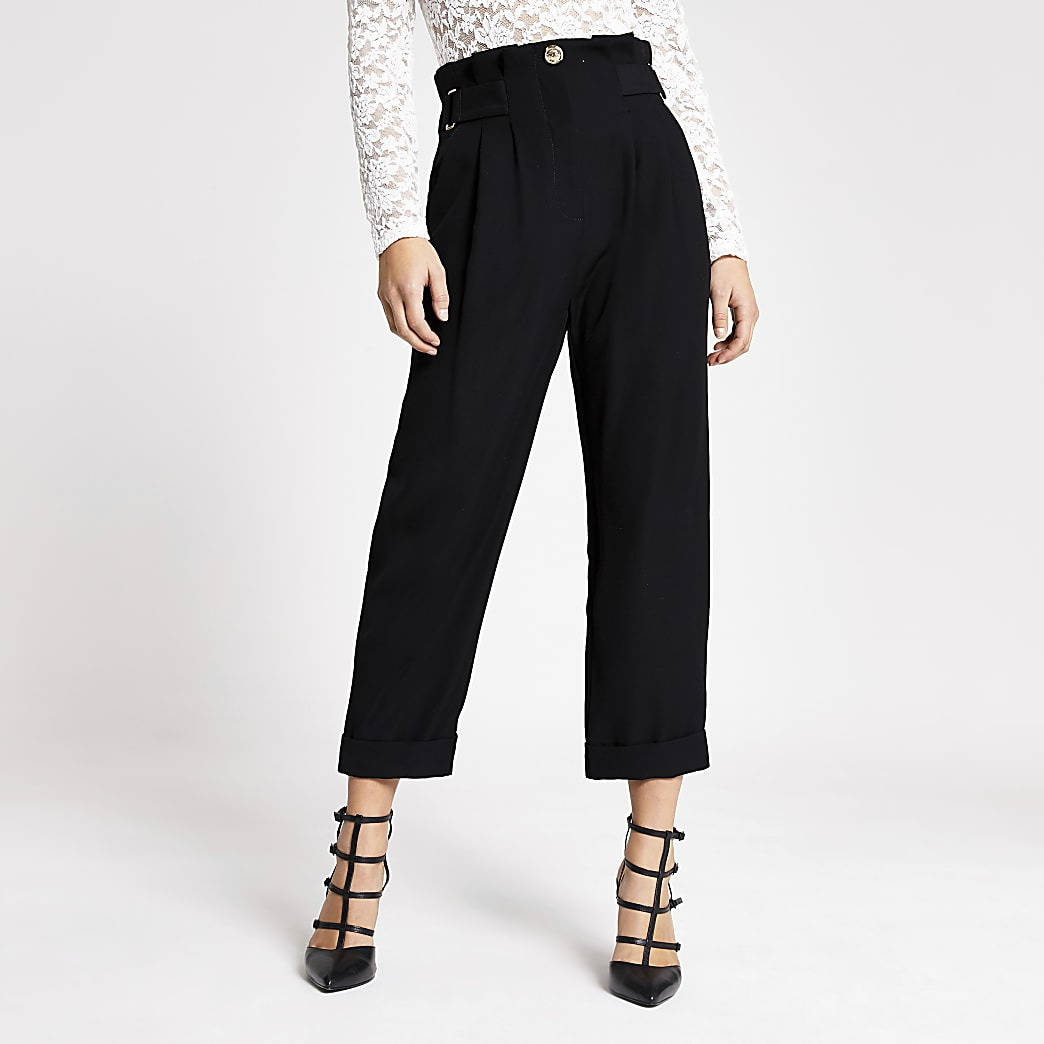 Petite black buckle peg leg trousers