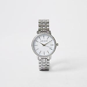 Zilverkleurig horloge met siersteentjes op de wijzerplaat