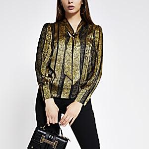 Goudkleurige blouse met strik rond de hals, print en lange mouwen