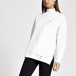 Crèmekleurige lange hoogsluitende sweater