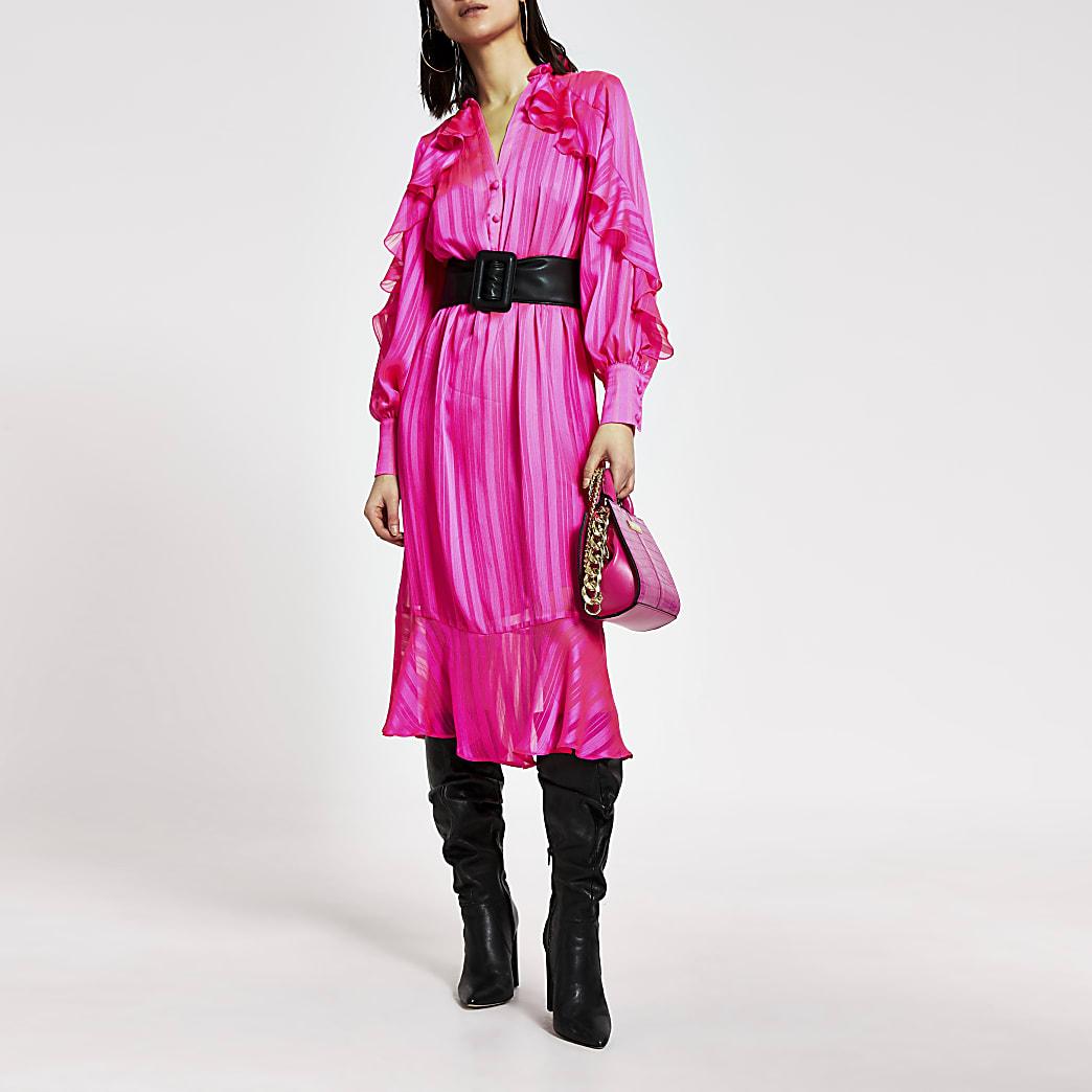 Robe mi-longue rose vifà volants avec ceinture
