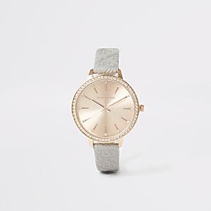 Roségoudkleurig horloge met reliëf en RI-print