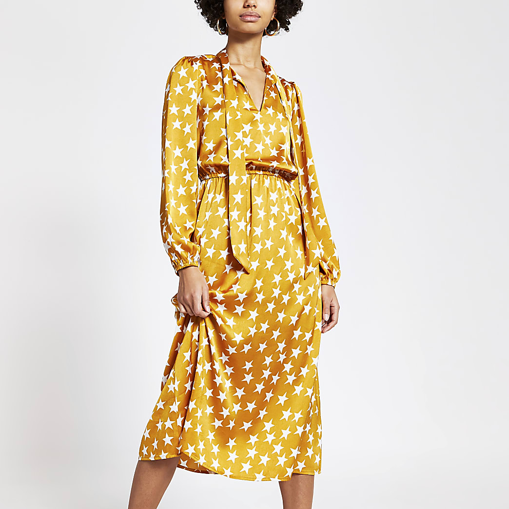 Robe mi-longue jaune imprimé étoiles avec col V noué