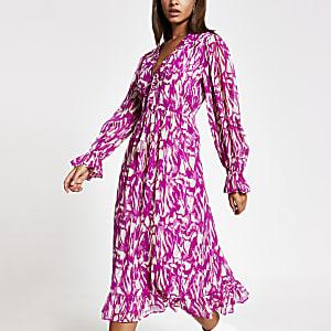 Pinkes, gesmoktes Midi-Kleid mit bedruckten, langen Ärmeln