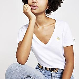 T-shirt blanc à col V et manches courtesà revers