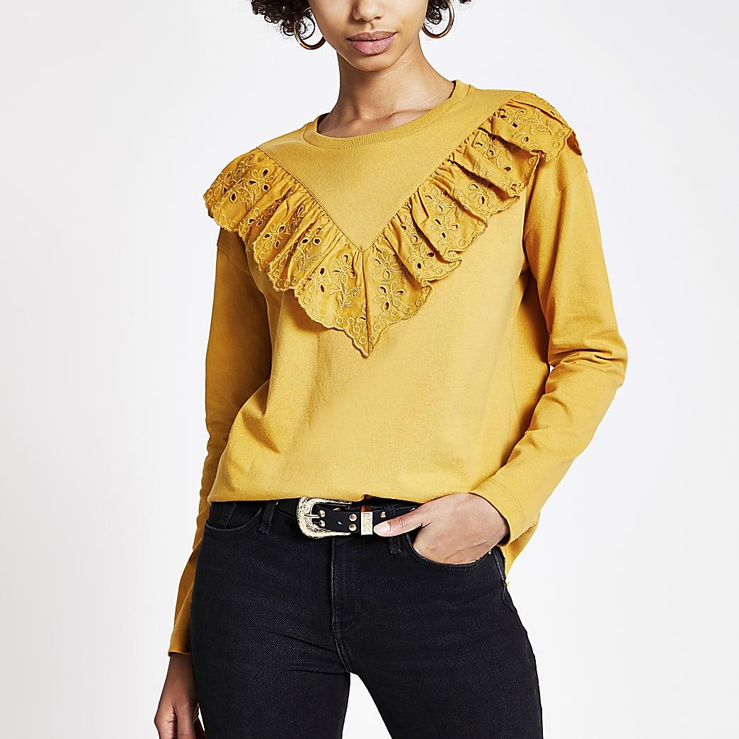 Geel T-shirt met broderie, ruches en lange mouwen