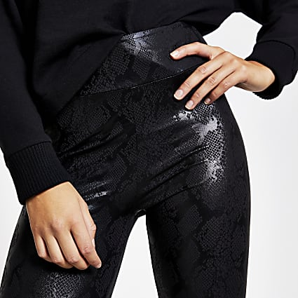 Black coated snake printed leggings