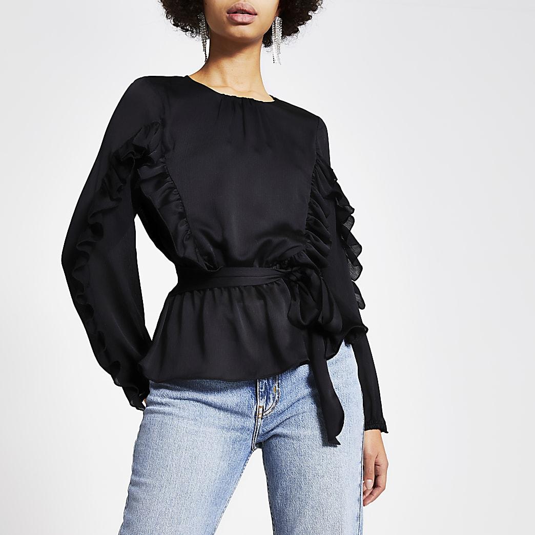 Zwarte blouse met strikceintuur, lange mouwen en ruches