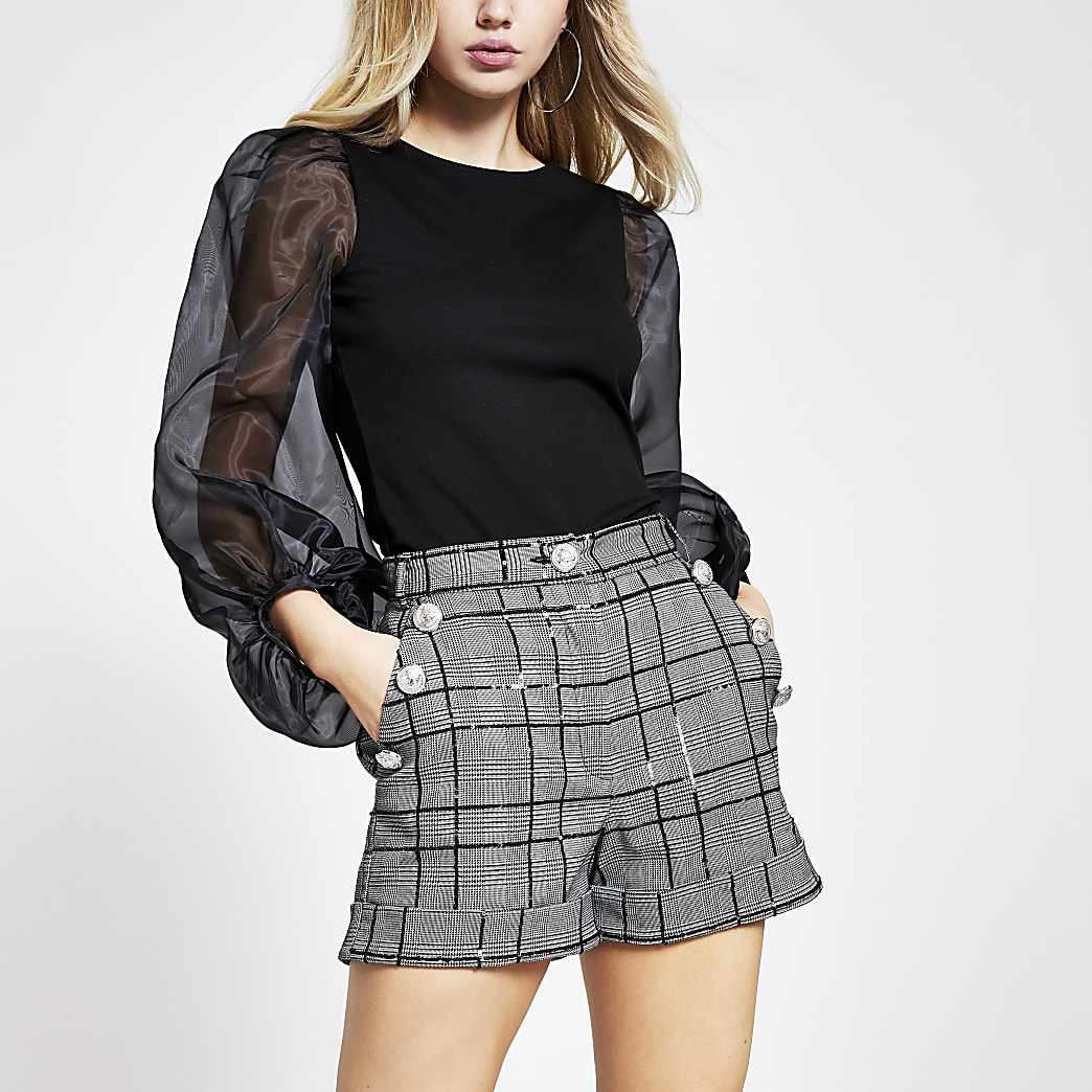 Black sequin check crested button shorts