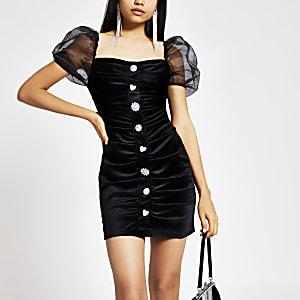 Mini-robe noire en veloursà manches bouffantes