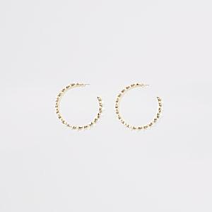 Goudkleurige ronde oorhangers met parels en siersteentjes