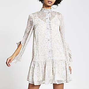 Crèmekleurige gesmokte mini-jurk met ruches en bloemenprint