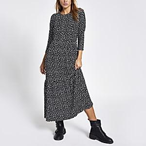 Zwarte gesmoktemidi-jurk met stippen