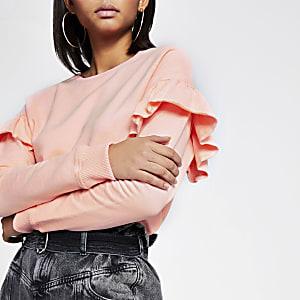 Roze sweater met lange mouwen en ruches
