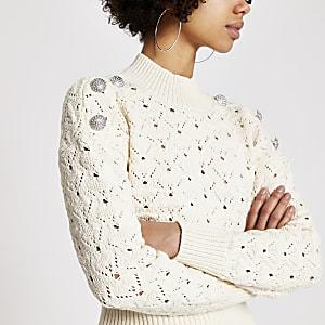 Crèmekleurige gebreide trui met knopen op schouder en siersteentjes