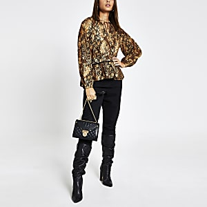 Bruine gesmokte blouse met dierenprint en lange mouwen