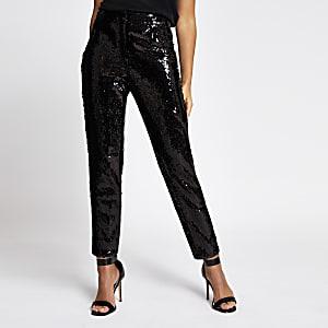Zwarte smaltoelopende jeans met lovertjes en hoge taille