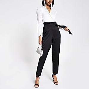 Zwarte 2-in-1 jumpsuit met overslag en strikceintuur