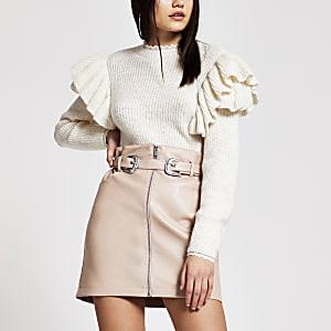 Mini-jupe en cuir synthétique rose zippée sur le devant avec ceinture