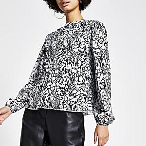 Zwarte geplooide blouse met print en lange mouwen