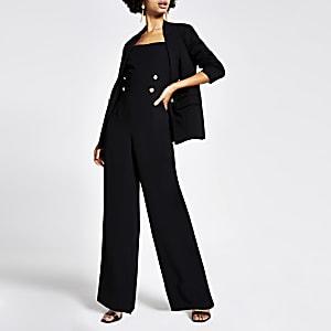 Zwarte jumpsuit met knopen voor en wijde pijpen