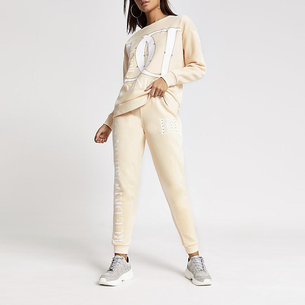 Pantalons de jogging crème imprimésà strass