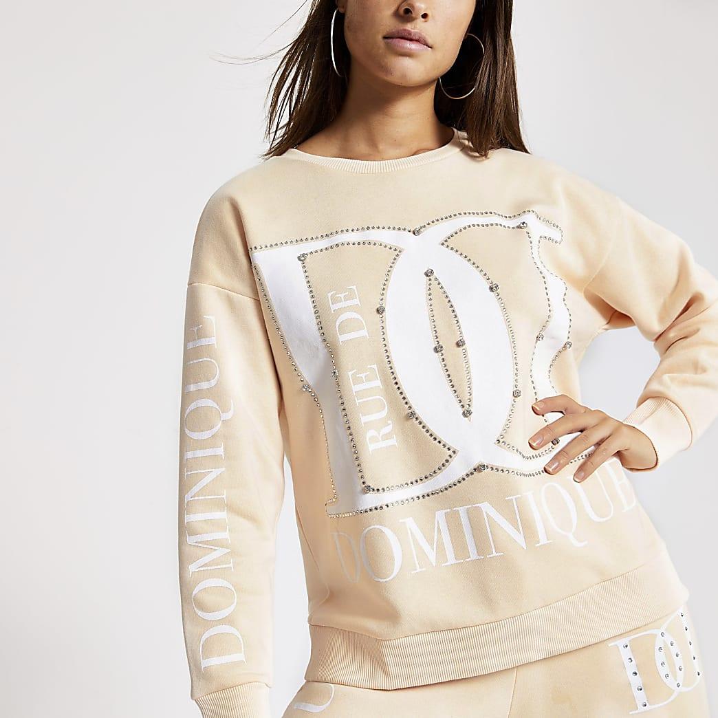Beige ruimvallende sweater met print en siersteentjes