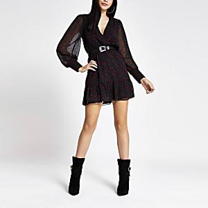 Zwarte overslag jurk met hartenprint en lange mouwen