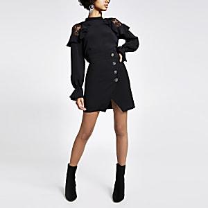 MIni-jupe portefeuille noire style smoking ornée