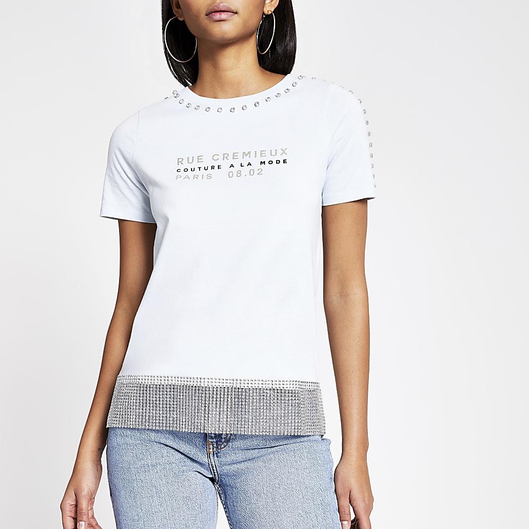 Blauw T-shirt met print en  siersteentjes afwerking