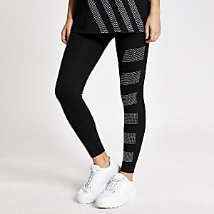 Schwarze Leggings mit strassbesetzten Blöcken