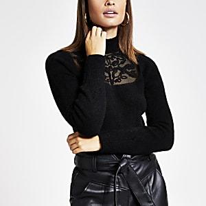 Zwarte gebreide trui met kant en mesh voor