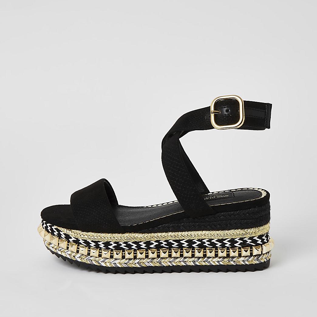Zwarte brede sandalen met studs en vlakke sleehak