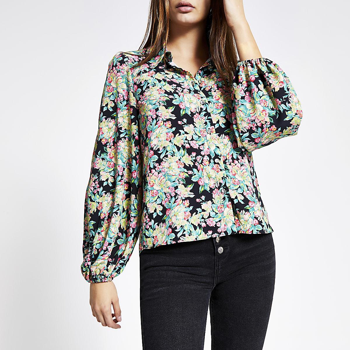 Chemise noire à manches longues bouffantes avec imprimé à fleurs