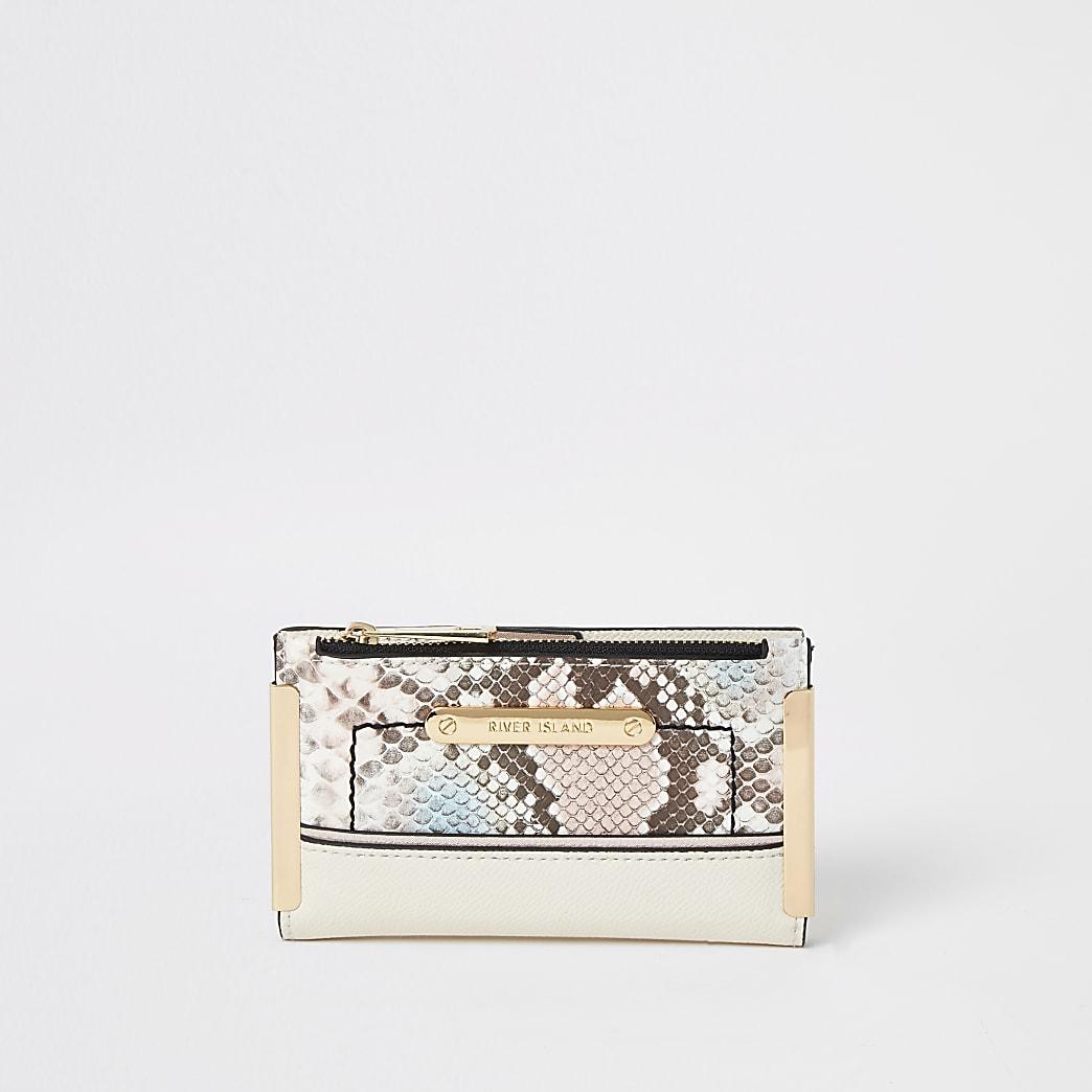 Roze uitklapbare mini-portemonnee met slangenprint in reliëf
