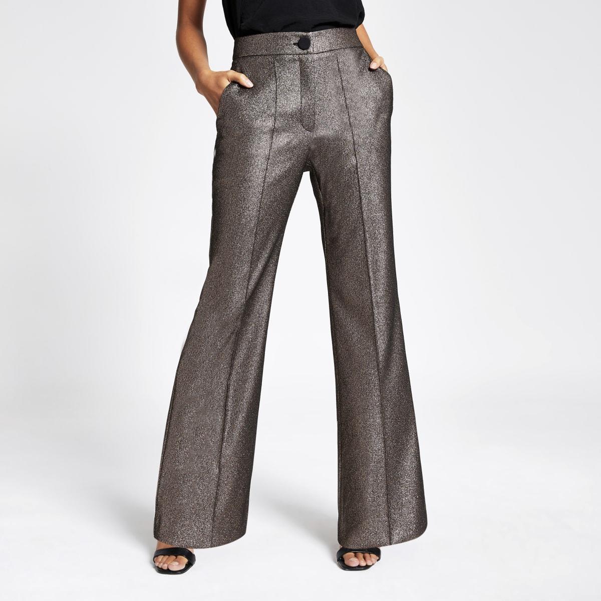 Goudkleurige metallic uitlopende broek met hoge taille