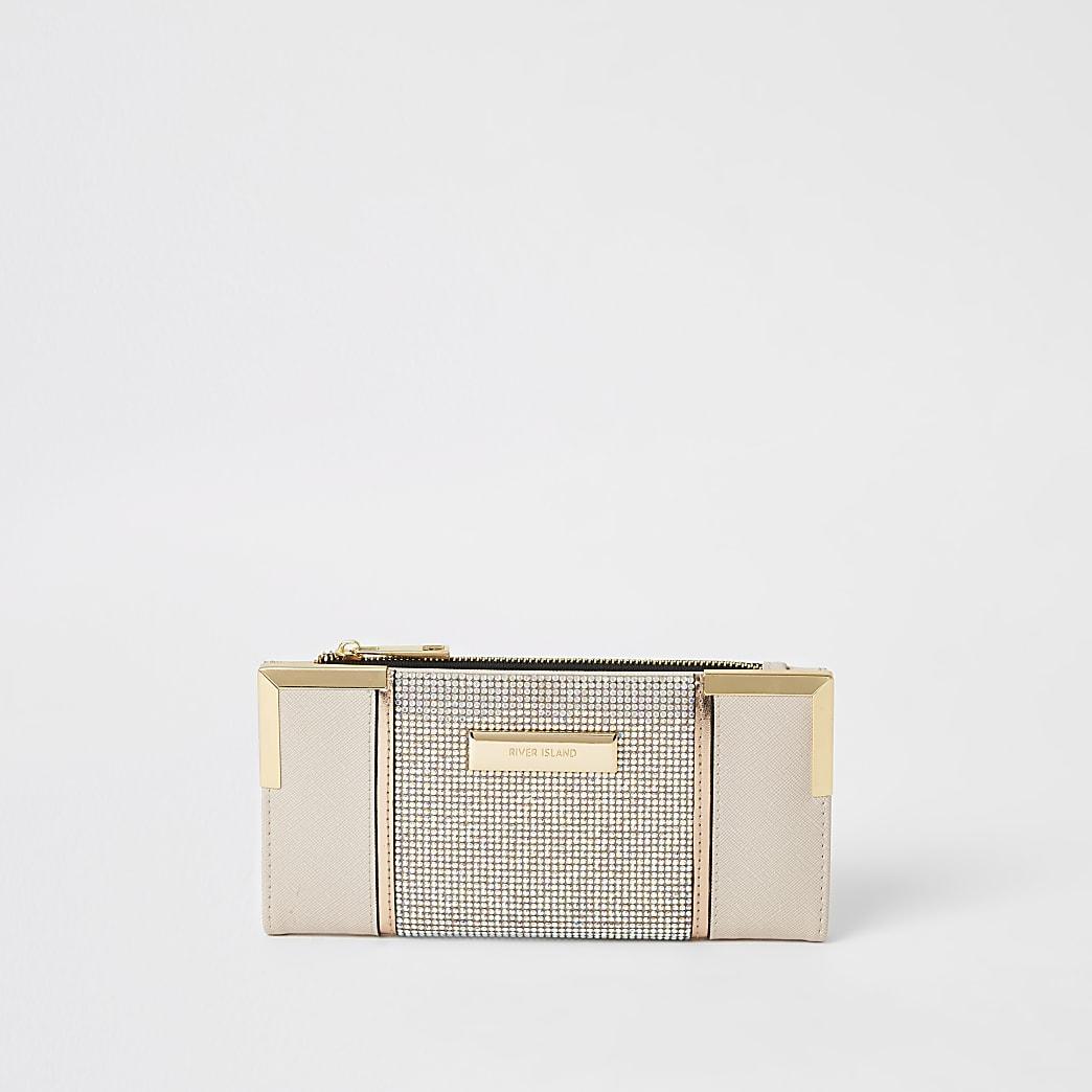 Roze uitvouwbare portemonnee met siersteentjes en metalen hoeken