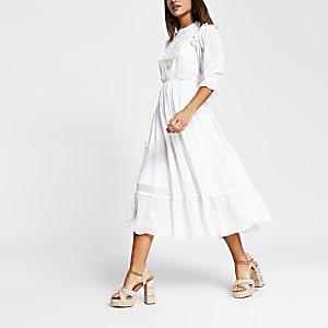 Witte broderie midi-jurk met kant en lange mouwen