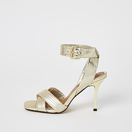 Gold metallic cross strap heeled sandals