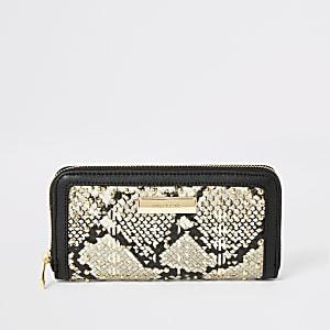 Beige portemonnee met rits rondom en slangenprint en studs