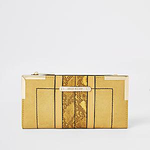 Portefeuille en suédine jaune à rabats et coins métalliques